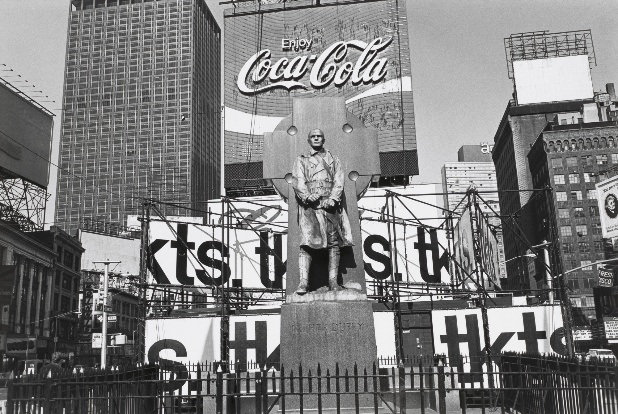Lee Friedlander. Father Duffy. Times Square, New York City. 1974