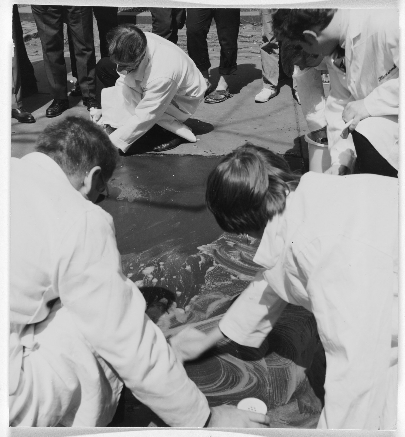 Hi Red Center, Genpei Akasegawa, Natsuyuki Nakanishi, Jiro Takamatsu. Street Cleaning Event (1964), performed during Fluxfest Presents Hi Red Center Street Cleaning Event, Grand Army Plaza, New York, June 11, 1966. 1966