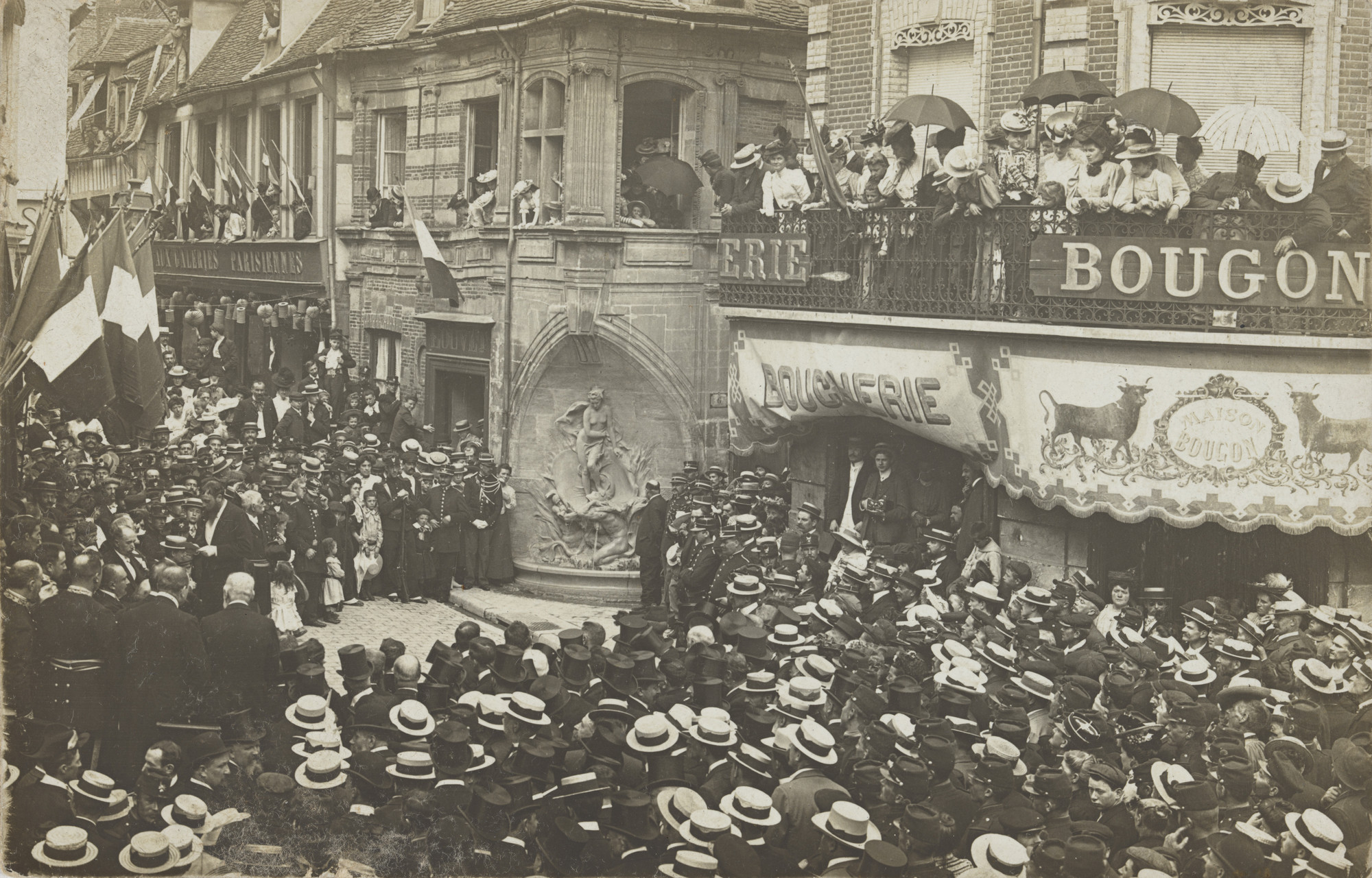 Unknown photographer. Boucherie, Maison Bougon, Fête devant la Fontaine des Amis des Arts, Rue de la Frette, Plaque Guilleminot. c. 1905