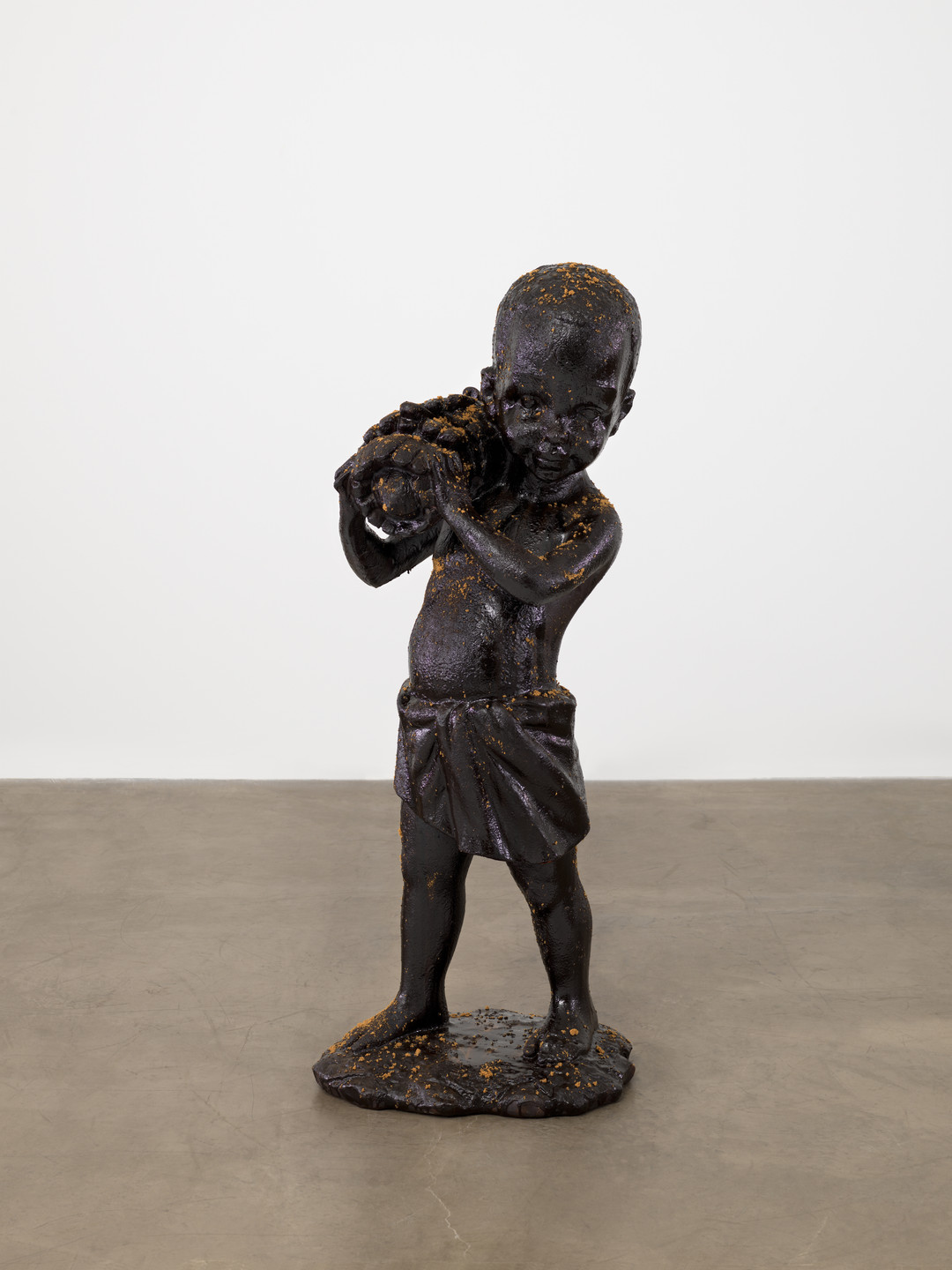 "Kara Walker. African Boy Attendant Curio with Molasses and Brown Sugar, from ""The Marvelous Sugar Baby"" Installation at the old Domino Sugar Factory Warehouse (Bananas). 2014"