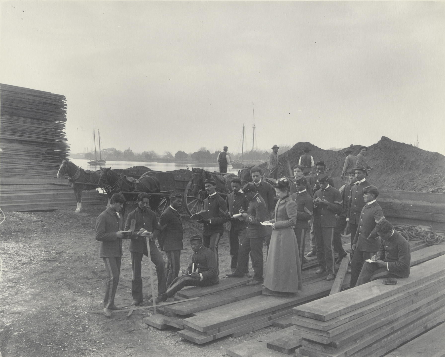 Frances Benjamin Johnston. Geography. Lesson on local industries. - lumber and coal at School wharf. 1899-1900