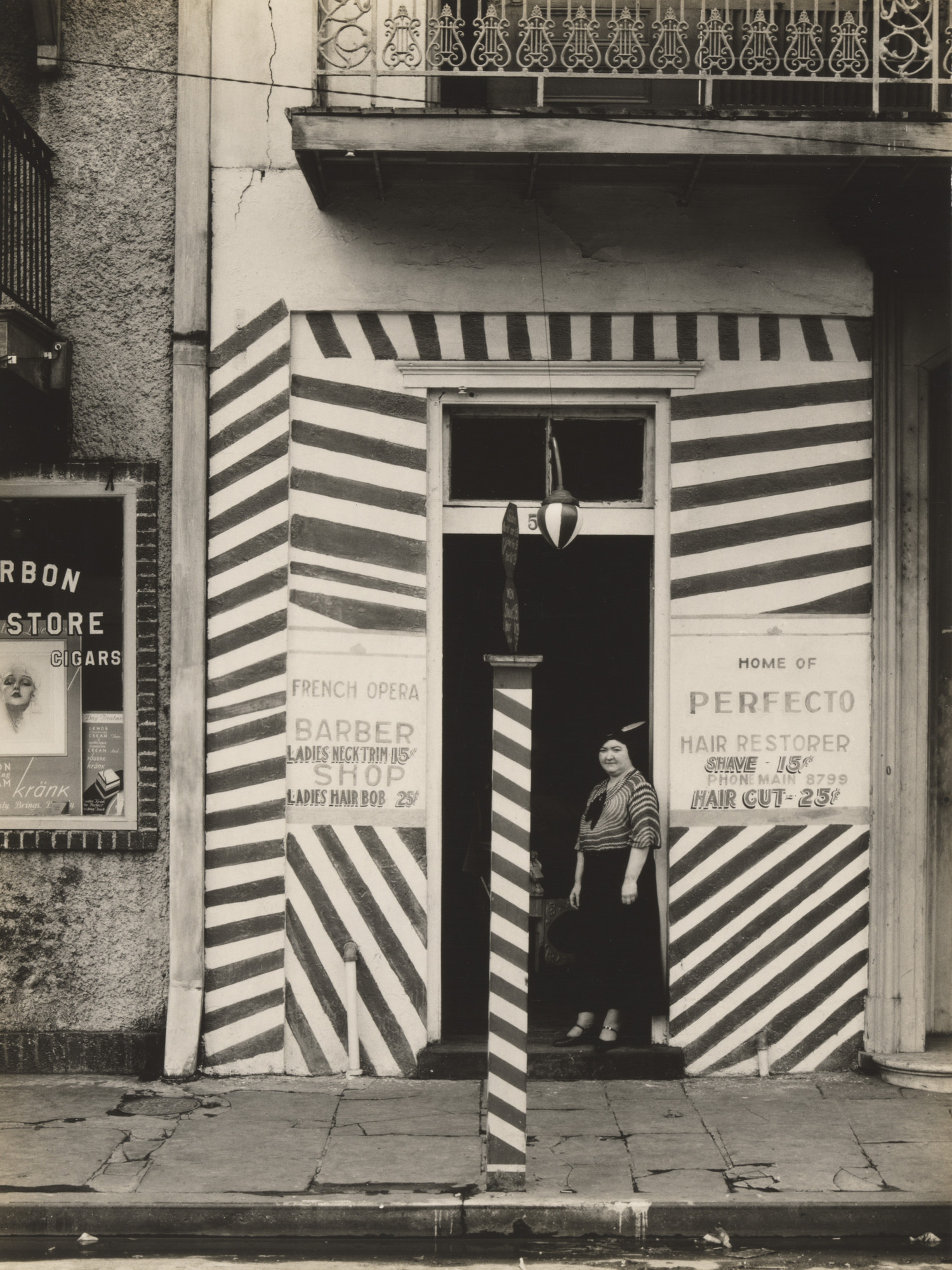Walker Evans. Sidewalk and Shopfront, New Orleans. 1935