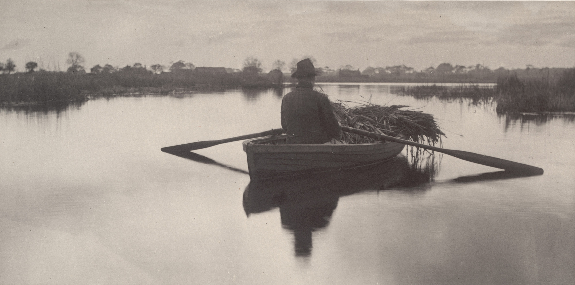 Peter Henry Emerson, T. F. Goodall. Rowing home the Schoof-Stuff from Life and Landscape on the Norfolk Broads (1886). c. 1885
