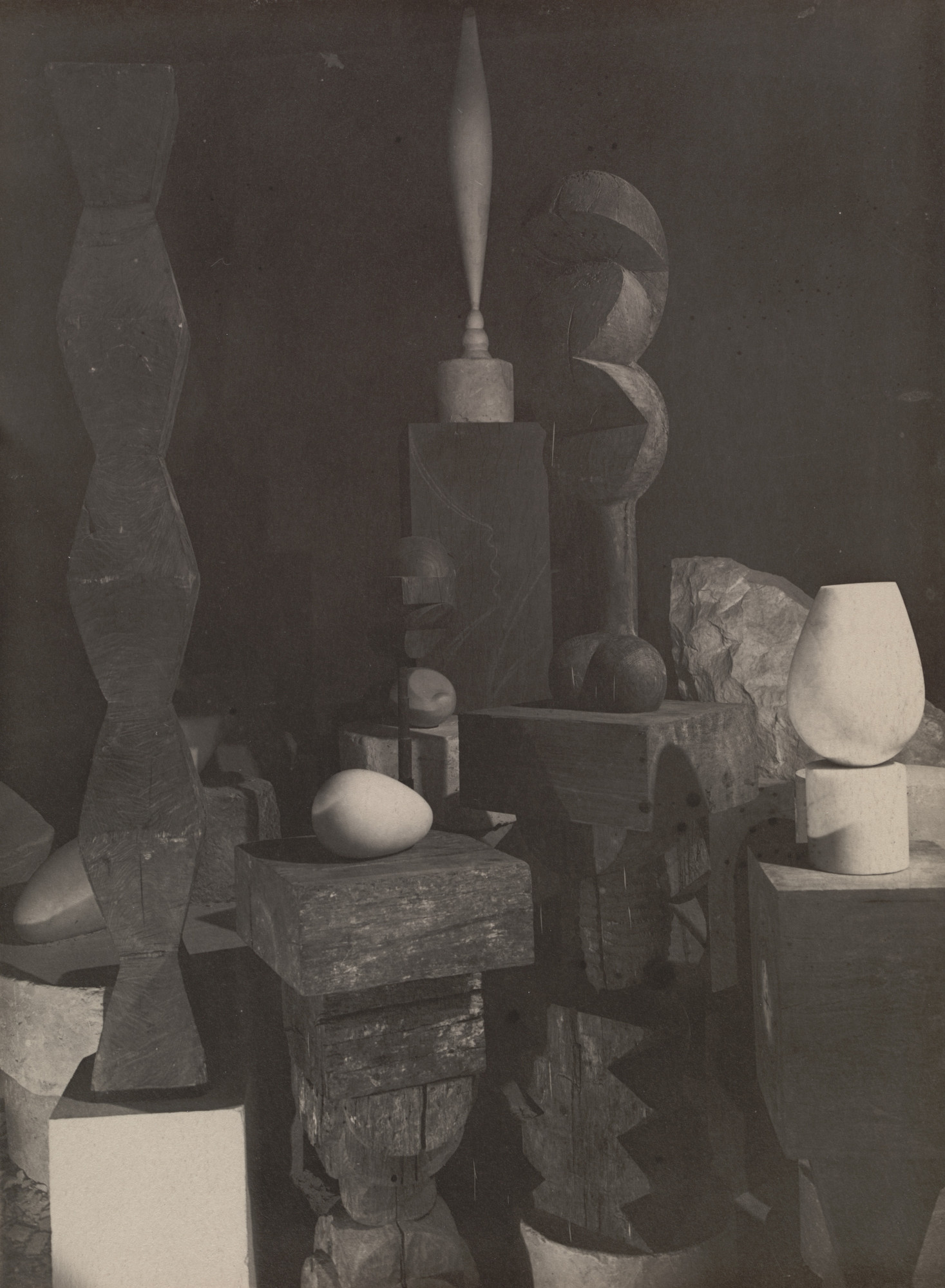 Constantin Brancusi. Untitled (View of the Studio with Endless Column, Beginning of the World, Adam and Eve, Bird in Space, and Torso of a Young Girl). 1922