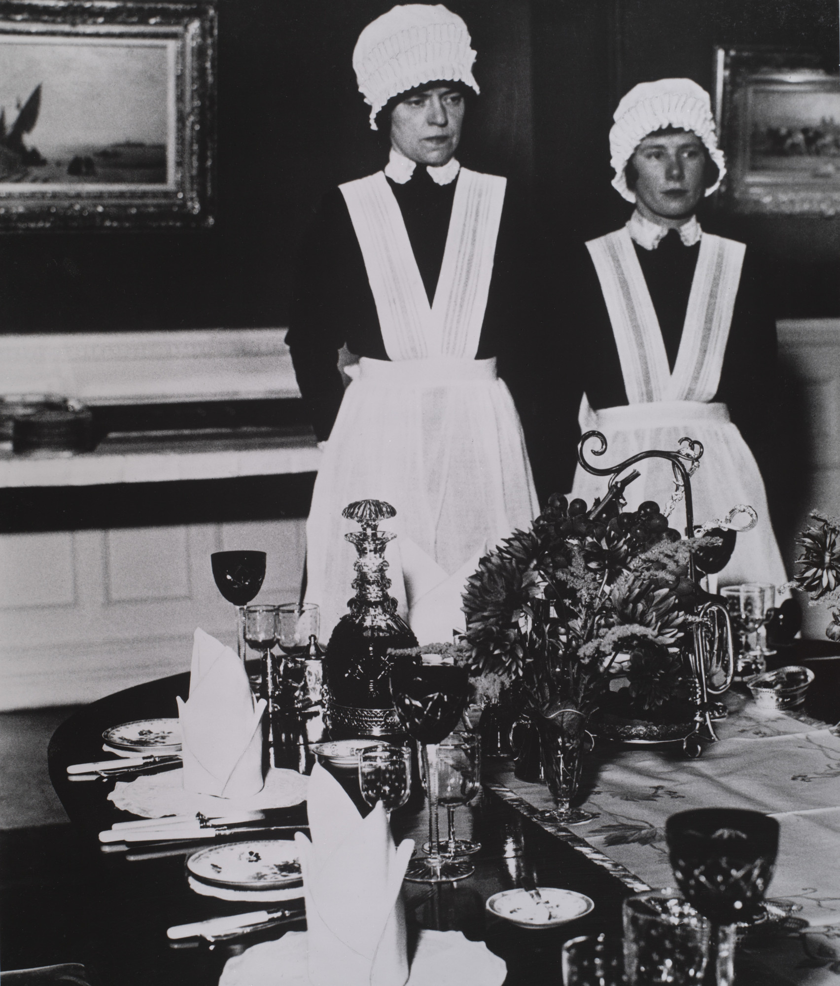 Bill Brandt. Parlourmaid and Under-parlourmaid Ready to Serve Dinner. 1936