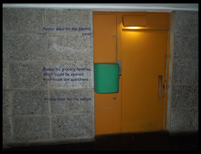 Image of the front door of an apartment in the Unité, with each of the hallway access panels.