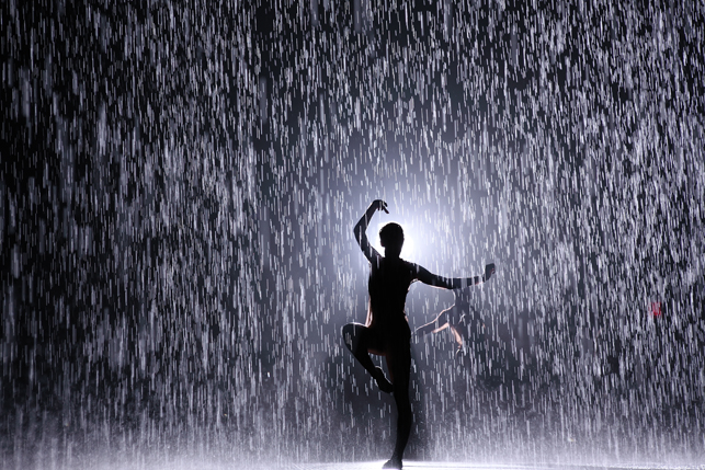 Random International. <em>Rain Room.</em> Installation view at The Museum of Modern Art with dancers from WayneMcGregor | Random Dance. <em>Rain Room</em> is part of MoMA PS1's <em>EXPO 1: New York</em>, 2013. Photo by Charles Roussel