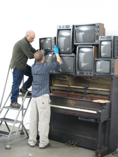 Installing the video sculpture after completing the conservation work