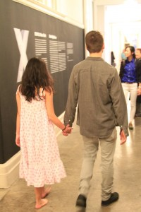 Alya Albert and Ryan McNamara holding hands as part of her performance piece