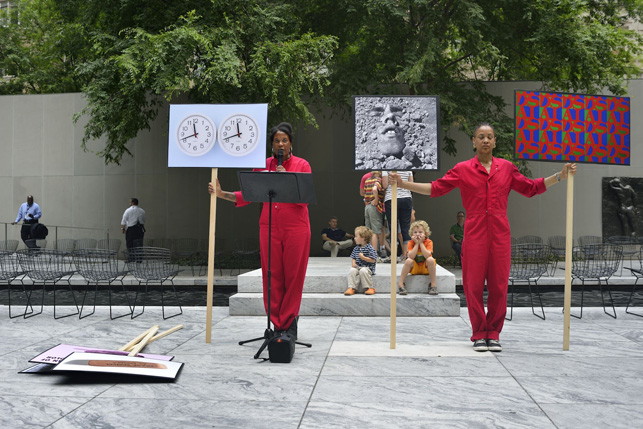 An Archive as Impetus performance in MoMA's Abby Aldrich Rockefeller Sculpture Garden. Photograph courtesy of Xaviera Simmons)
