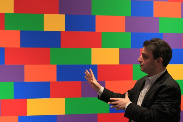 Instructor Pablo Helguera in MoMA's galleries. Art featured: Sol LeWitt. Wall Drawing #1144, Broken Bands of Color in Four Directions. 2004. Synthetic polymer paint. Given anonymously. © 2013 Sol LeWitt/Artists Rights Society (ARS), New York