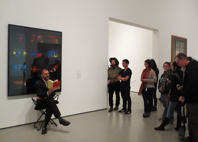 Kenneth Goldsmith performs a guerilla reading in the MoMA galleries.