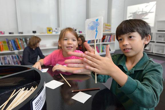 A thaumatrope activity in MoMA Art Lab: Movement. Photo: Martin Seck