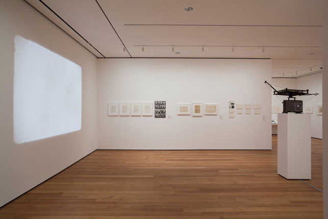 "Installation view of There Will Never Be Silence: Scoring John Cage's 4'33"". Foreground: Nam June Paik. Zen for Film. 1965. 16mm film leader (silent), 20 min. (approx.). The Museum of Modern Art, New York. The Gilbert and Lila Silverman Fluxus Collection Gift. © 2014 Nam June Paik"