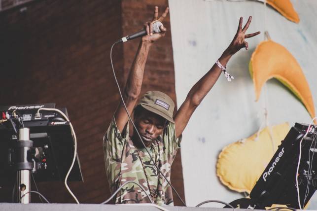 DJ Spoko feeling the love from the crowd. MoMA PS1 Warm Up, Saturday, June 28, 2014. Photo: Charles Roussell