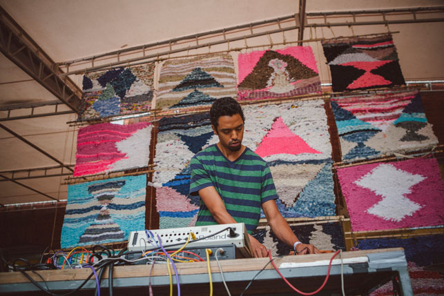 Gifted and Blessed performing in front of Nightwood's woven backdrop. MoMA PS1 Warm Up, Saturday, August 23, 2014. Photo: Margarida Malarkey