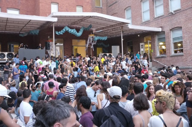 The crowd gets ready for an afternoon of dancing under the Chen Chen & Kai Williams installation. MoMA PS1 Warm Up, Saturday, August 16, 2014. Photo: Manuela Paz