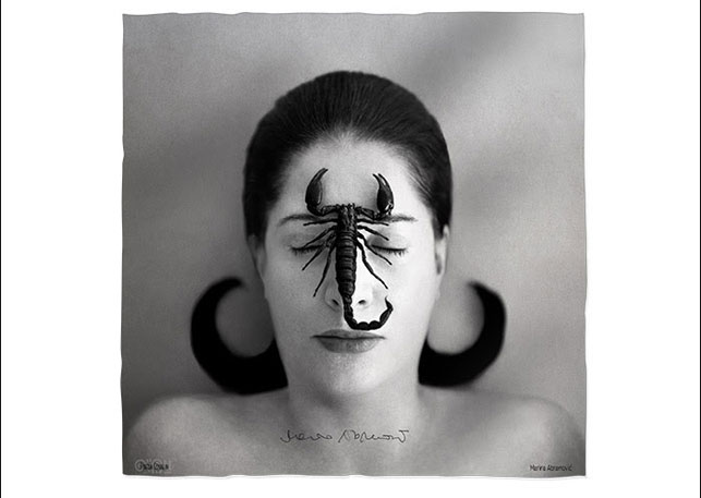 Marina Abramović's Portrait with Scorpion (Closed Eyes) (2005), shown reproduced on the limited-edition scarf, with signature