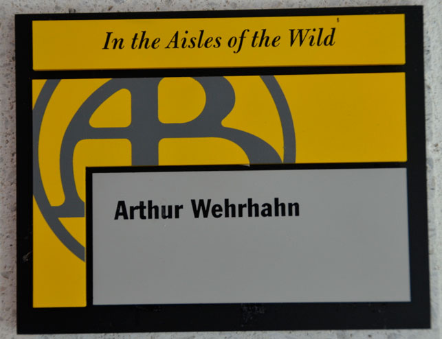 The nameplate on Art Wehrhahn's office door in Hamlin. The film it refers to, In the Aisles of the Wild, is a silent 1912 Biograph Film directed by D. W. Griffith. All of the rooms in the Bartos Center have plates that announce a Biograph film and cheekily refer to what goes on in the room and/or the person who inhabits the office space.