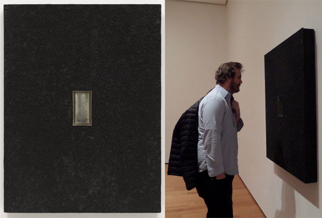 "From left: Donald Judd. Relief. 1961. Oil on composition board mounted on wood, with inset tinned steel baking pan, 48 1/8 x 36 1/8 x 4"" (122.2 x 91.8 x 10.2 cm). The Museum of Modern Art, New York. Gift of Barbara Rose. Photograph by Jonathan Muzikar; Michael Williams examines Relief. Photograph by Naomi Kuromiya"