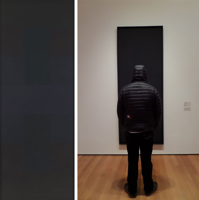 "From left: Ad Reinhardt. Abstract Painting. 1957. Oil on canvas, 9' x 40"" (274.3 x 101.5 cm). The Museum of Modern Art, New York. Purchase. Photograph by John Wronn. © 2015 Estate of Ad Reinhardt/Artists Rights Society (ARS), New York; Michael Williams examines Abstract Painting. Photograph by Naomi Kuromiya"