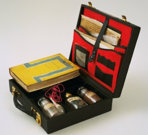 "John Latham. Art and Culture. 1966–69. Leather case containing book, letters, photostats, and labeled vials filled with powders and liquids, 3 1/8 x 11 1/8 x 10"" (7.9 x 28.2 x 25.3 cm). The Museum of Modern Art, New York. Blanchette Hooker Rockefeller Fund. © 2015 John Latham"