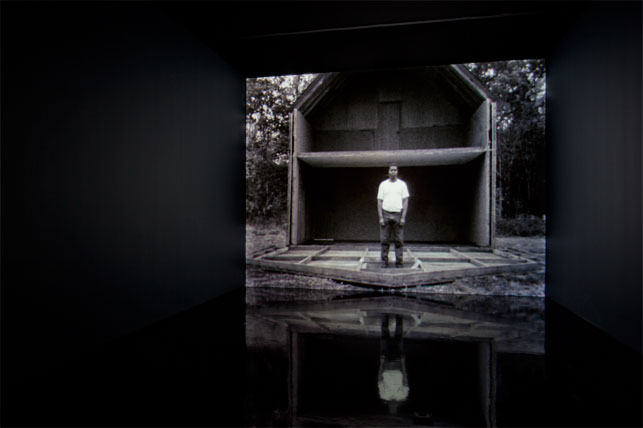 Steve McQueen. Deadpan. 1997. 16mm film transferred to video (black and white, silent), 4:35 min. The Museum of Modern Art, New York. Fractional and promised gift of Thea Westreich and Ethan Wagner. Installation view, The Museum of Modern Art 2012. Photo: Jonathan Muzikar. © 2015 The Museum of Modern Art