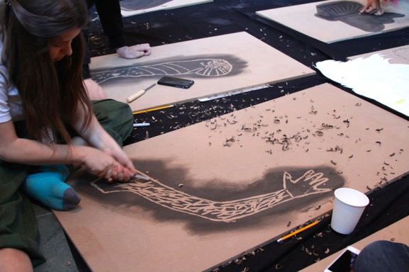 Carving large-scale woodblocks for the final collaborative project