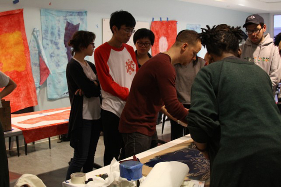 Artist Yashua Klos oversees another printmaking project