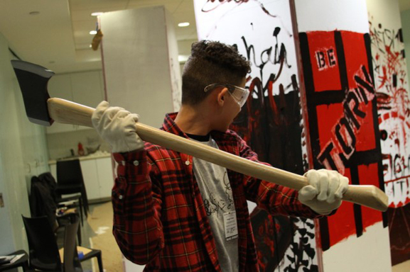 Taking an ax to a sculptural object on the first day of Destroy Everything. All photos by Calder Zwicky