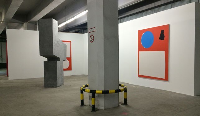 The exhibition Concrete Utopias, organized by the Realismus club, in a parking garage in Berlin. Photo: Hannah Felt Garner
