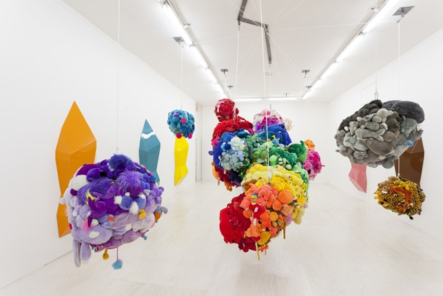 Mike Kelley. Deodorized Central Mass with Satellites. 1991/1999. Plush toys sewn over wood and wire frames with styrofoam packing material, nylon rope, pulleys, steel hardware and hanging plates, fiberglass, car paint, and disinfectant, Overall dimensions variable. Partial gift of Peter M. Brant, courtesy the Brant Foundation, Inc. and gift of The Sidney and Harriet Janis Collection (by exchange), Mary Sisler Bequest (by exchange), Mr. and Mrs. Eli Wallach (by exchange), The Jill and Peter Kraus Endowed Fund for Contemporary Acquisitions, Anne and Joel Ehrenkranz, Mimi Haas, Ninah and Michael Lynne, and Maja Oeri and Hans Bodenmann