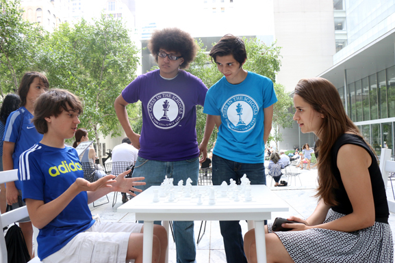 Participants playing an exhibition copy of Yoko Ono's White Chess Set (1966/2015) in MoMA's Abby Aldrich Rockefeller Sculpture Garden. All photos: Manuel Martagon. © 2015 The Museum of Modern Art, New York