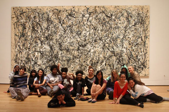 "The House of Horrors crew poses in front of a Jackson Pollock. Photo: Calder Zwicky. Shown: Jackson Pollock. One: Number 31, 1950. 1950. Oil and enamel paint on canvas, 8' 10"" x 17' 5 5/8"" (269.5 x 530.8 cm). Sidney and Harriet Janis Collection Fund (by exchange). © 2015 Pollock-Krasner Foundation/Artists Rights Society (ARS), New York"