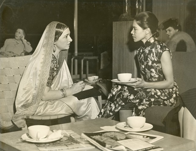 """Left to right: Ragini Devi and Si-Lan-Chen at Dance Archives Tea, October 22, 1940, from the exhibition album, """"Forty Years of the American Dance"""" {alternate title used in Museum Press Release: """"American Dancing and the Denishawns""""} October 23, 1940 through November 19, 1940"""