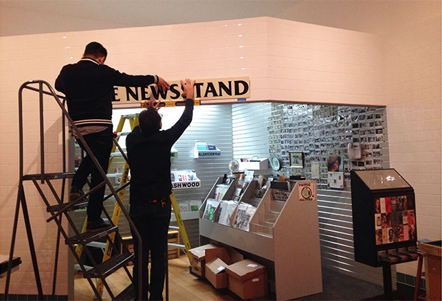 Installing Lele Saveri's The Newsstand. 2013–14. Mixed-medium installation. Produced in collaboration with Alldayeveryday. Courtesy the artist. Photo: Kristen Gaylord