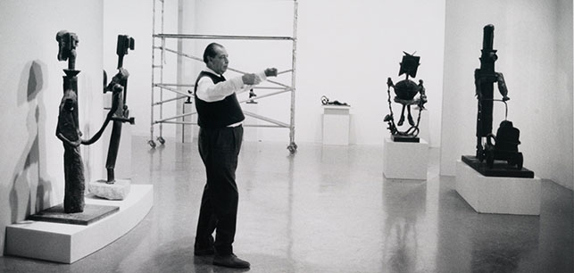 René d'Harnoncourt, Director of the Museum, installing the exhibtion. Photograph by Dan Budnik. Photographic Archive. The Museum of Modern Art Archives, New York