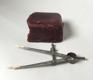 Block of French casting wax and bamboo-tipped calipers