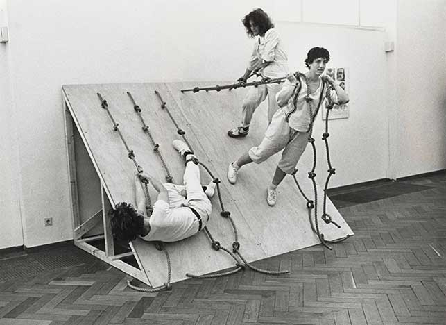 Slant Board (1961), performed at the Stedelijk Museum, Amsterdam, 1982. Photograph. The Museum of Modern Art, New York. © 2016 Simone Forti