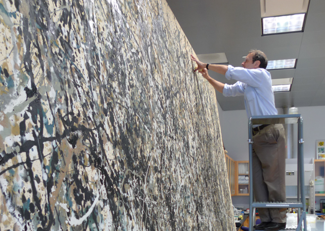 Conservator Jim Coddington beginning conservation treatment of Jackson Pollock's One: Number 31, 1950