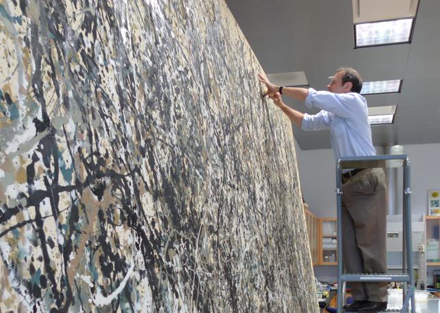 Conservator Jim Coddington beginning conservation treatment of Jackson Pollock's One: Number 31, 1950
