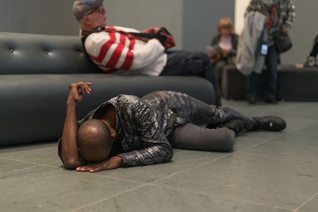 Maria Hassabi. PLASTIC. 2015. Installation view, The Museum of Modern Art, February 21–March 20, 2016. Pictured: David Thomson. Photo: Thomas Poravas. © Maria Hassabi