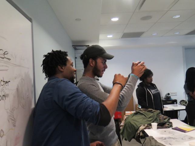 Visiting Artist, James Sprang teaches Jeancarlo some camera tricks