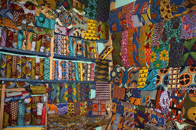 Waxprints sold in a shop in West Africa, 2009. Photo: Alexander Sarley. Used via Creative Commons license