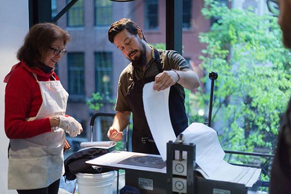 Justin Sanz of EFA's Robert Blackburn Printmaking Workshop pulling a print. Photo: Beatriz Meseguer/onwhitewall.com. © 2016 The Museum of Modern Art, New York