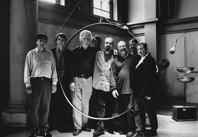 David Tudor Memorial,  Judson Church, New York, 1996. From left: Paul DeMarinis, John D.S. Adams, John Driscoll, Phil Edelstein, Bill Viola, Russel Frehling, D'Arcy Philip Gray, Linda Fisher. Photo © 1996 Stan Ries