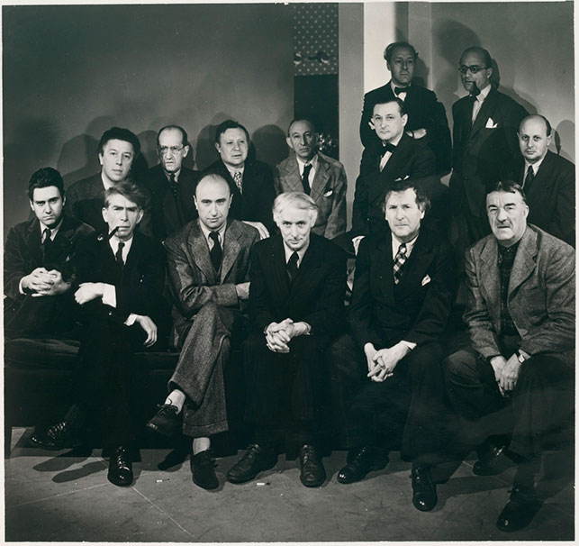 Photograph taken on the occasion of the exhibition Artists in Exile, Pierre Matisse Gallery, New York, March 1942. First row, left to right: Matta Echaurren, Ossip Zadkine, Yves Tanguy, Max Ernst, Marc Chagall, Fernand Léger; second row: André Breton, Piet Mondrian, André Masson, Amédee Ozenfant, Jacques Lipchitz, Pavel Tchelitchew, Kurt Seligmann, Eugene Berman. A number of these artists were aided by the Museum.  Photo: George Platt Lynes. Photographic Archive. The Museum of Modern Art Archives, New York