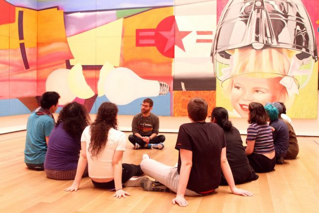 The author, center, leading OAS participants through a conversation in the galleries (Photo by Kaitlyn Stubbs)