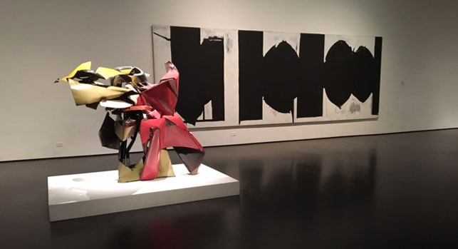 From left: John Chamberlain. Sweet William. 1962; Robert Motherwell. Elegy to the Spanish Republic, 100. 1963–75. Installation view, Los Angeles Country Museum of Art, Los Angeles. Photo: Isabel Ross
