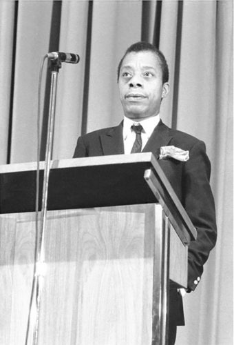 """James Baldwin at """"A Literary Evening in Honor of Dr. Martin Luther King, Jr."""" Photographic Archive. MoMA Archives, NY"""